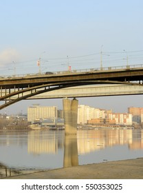 Novosibirsk, Russia - may 04, 2016 City river Bank with buildings and road bridge in Novosibirsk in the spring of 04 may 2016.