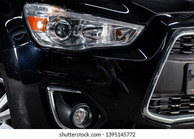 Novosibirsk, Russia - May 10, 2019:  Mitsubishi ASX,close-up of the headlights. Photography of a modern car on a parking in Novosibirsk
