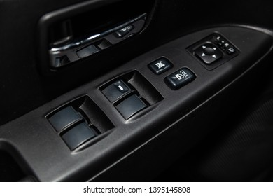 Novosibirsk, Russia - May 10, 2019:  Mitsubishi ASX,close-up of the side door buttons: window adjustment buttons, door lock. Photography of a modern car on a parking in Novosibirsk