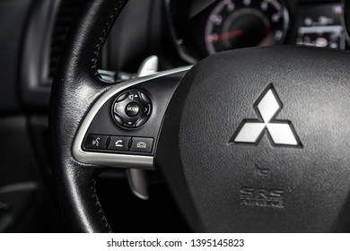 Novosibirsk, Russia - May 10, 2019:  Mitsubishi ASX,close-up of the Multiwheel with phone setting and volume buttons. Photography of a modern car on a parking in Novosibirsk