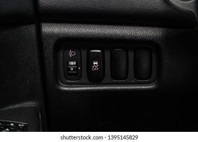 Novosibirsk, Russia - May 10, 2019:  Mitsubishi ASX,close-up of the headlight adjustment buttons. Photography of a modern car on a parking in Novosibirsk