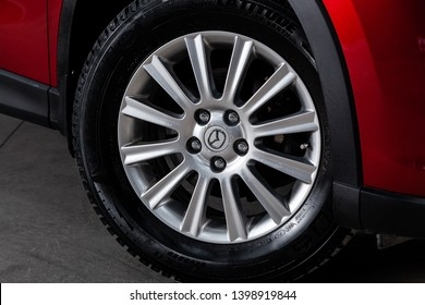 Novosibirsk, Russia - May 15, 2019:  Mazda CX-5,close-up of the wheel. Photography of a modern car on a parking in Novosibirsk