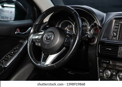 Novosibirsk, Russia - May 15, 2019:  Mazda CX-5,close-up of the dashboard, speedometer, tachometer and steering wheel.Photography of a modern car on a parking in Novosibirsk