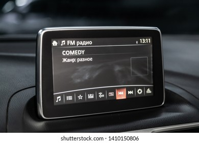 Novosibirsk, Russia - May 18, 2019:  Mazda 3,close-up of the dashboard,  monitor with radio, navigator, player. Photography of a modern car on a parking in Novosibirsk