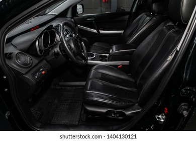 Novosibirsk, Russia - May 20, 2019:  Mazda CX-7, close-up of the dashboard, speedometer, tachometer, seats and steering wheel.Photography of a modern car on a parking in Novosibirsk