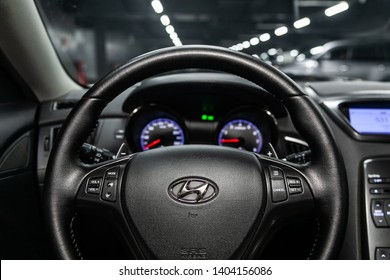 Novosibirsk, Russia - May 20, 2019:  Hyundai Genesis,close-up of the dashboard, speedometer, tachometer and steering wheel.Photography of a modern car on a parking in Novosibirsk