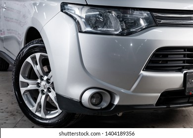 Novosibirsk, Russia - May 20, 2019:  Mitsubishi Outlander, close-up of the headlights. Photography of a modern car on a parking in Novosibirsk