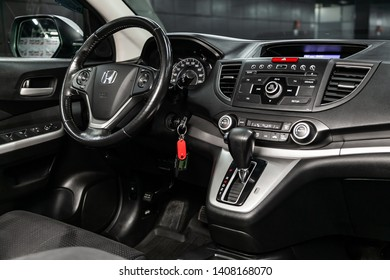Novosibirsk, Russia - May 23, 2019:  Honda CR-V, close-up of the dashboard, speedometer, tachometer, black seats and steering wheel.Photography of a modern car on a parking in Novosibirsk