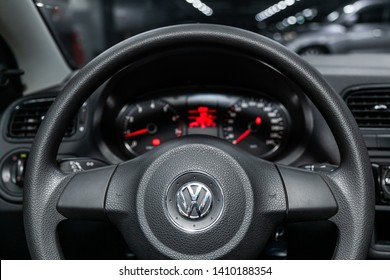 Novosibirsk, Russia - May 28, 2019:  Volkswagen Polo, close-up of the dashboard, speedometer, tachometer and steering wheel.Photography of a modern car on a parking in Novosibirsk