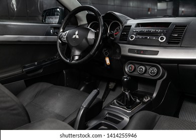 Novosibirsk, Russia - May 31, 2019:  Mitsubishi Lancer,close-up of the dashboard, speedometer, tachometer, black seats and steering wheel.Photography of a modern interior car.