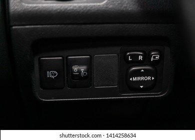 Novosibirsk, Russia - May 31, 2019:  Toyota Corolla,close-up of the headlight, mirrow and other adjustment buttons. Photography of a modern car on a parking in Novosibirsk