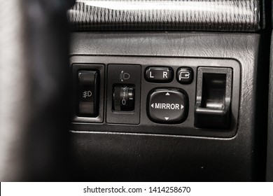 Novosibirsk, Russia - May 31, 2019:   Toyota Fielder,close-up of the mirrow adjustment buttons. Photography of  modern car on a parking in Novosibirsk