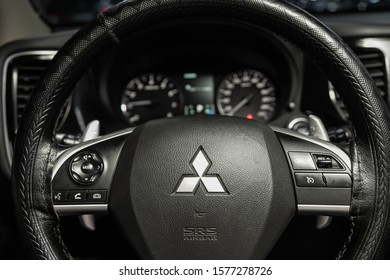 Novosibirsk, Russia – November 06, 2019:  Mitsubishi Outlander,Black luxury car Interior - dashboard, player, steering wheel with logo and buttons, speedometer and tachometer