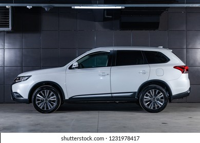 Novosibirsk, Russia - November 16, 2018:  white Mitsubishi Outlander, side view. Photography of a modern car on a parking in Novosibirsk