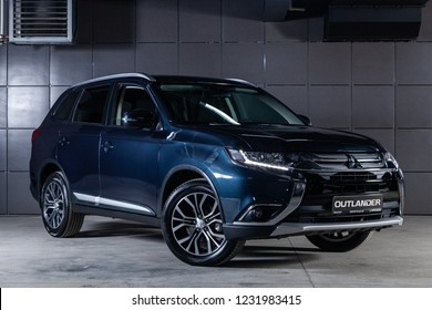 Novosibirsk, Russia - November 16, 2018:  blue Mitsubishi Outlander, front view. Photography of a modern car on a parking in Novosibirsk