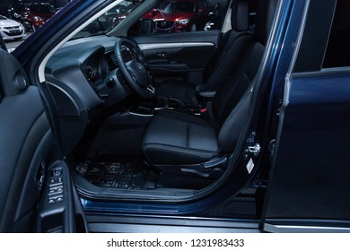 Novosibirsk, Russia - November 16, 2018: blue Mitsubishi Outlander, close-up of the dashboard, whellls and seats, side view. Photography of a modern car on a parking in Novosibirsk