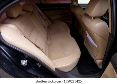 Novosibirsk, Russia – October 10, 2019:  Honda Civic, beige interior design, car passenger and driver seats with seats belt.
