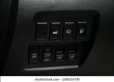 Novosibirsk, Russia – October 13, 2019:  Nissan Murano, close-up button for opening the trunk, washing the headlights, opening the fuel tank flap and other buttons
