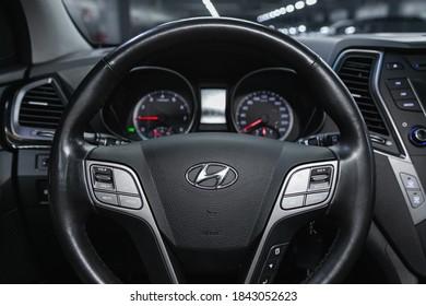 Novosibirsk, Russia – October 22, 2020:  Hyundai Santa fe, Auto interior: steering wheel with  logo    and  speedometer and tachometer