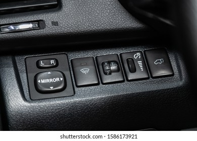 Novosibirsk, Russia – October 23, 2019:  Toyota Highlander, close-up of the  buttons: side mirror, headlight adjustment and open trunk buttons, windshield washer. modern car interior