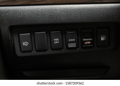 Novosibirsk, Russia – October 23, 2019:  Nissan Teana, close-up of the  buttons:  headlight adjustment, headlight washer and VDC, 4 WD, open trunk and other buttons. modern car interior