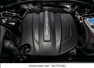 Novosibirsk, Russia – September 07, 2019:  Porsche Macan, Close up detail of  car engine, front view. Internal combustion engine, car parts, deteyling