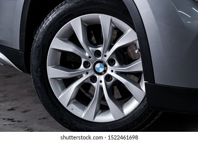 Novosibirsk, Russia – September 11, 2019:  BMW X1 , close-up of the bumper, alloy wheel, car detailing  with sport breaks