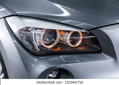 Novosibirsk, Russia – September 11, 2019:  BMW X1 , close-up of the headlight, bumper, wheel. Photography of a modern car on a parking in Novosibirsk