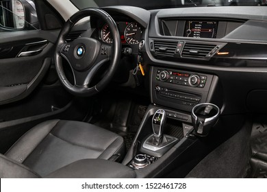 Novosibirsk, Russia – September 11, 2019:  BMW X1 , Black luxury car Interior - steering wheel, shift lever, multimedia  systeme, driver seats and dashboard
