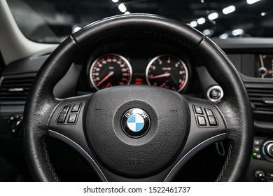 Novosibirsk, Russia – September 11, 2019:  BMW X1 , Black luxury car Interior - dashboard, player, steering wheel, speedometer