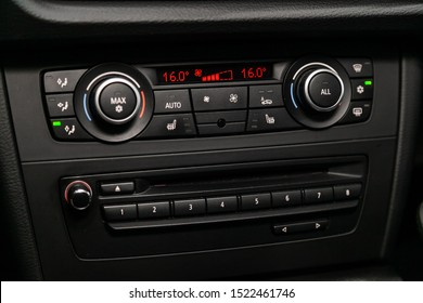 Novosibirsk, Russia – September 11, 2019:  BMW X1 , Car, vehicle interior with visible climate controls, adjustment of the fragment of instrument panel.