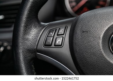 Novosibirsk, Russia – September 11, 2019:  BMW X1 , close-up of the Multiwheel with phone setting and volume buttons. Photography of a modern car on a parking in Novosibirsk. modern car interior