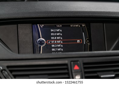 Novosibirsk, Russia – September 11, 2019:  BMW X1 , Modern black car interior: radio, tv, dvd,audio system with monitor  and control buttons