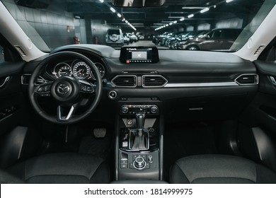 Novosibirsk, Russia – September 12, 2020  Mazda CX-5, Dark car Interior - steering wheel, shift lever and dashboard, climate control, speedometer, display. Salon of a new stylish car