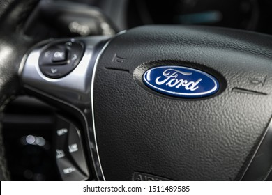 Novosibirsk, Russia – September 18, 2019:  close-up, blue Ford nameplate logo  on a black plastic steering wheel