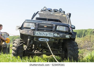 """Novosibirsk, Russia-June 5, 2016: iron protective bumper Japanese off-road car """"Suzuki Escudo"""" with winch and mud wheels on a mountain in Novosibirsk on June 5, 2016."""