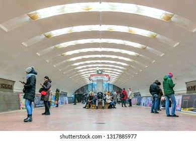 Novosibirsk, Siberia, Russia - November 19, 2018: Novosibirsk metro. Station Ploschad Lenina (Lenin Square). Passengers on the platform, waiting for the train, look into their smartphones.