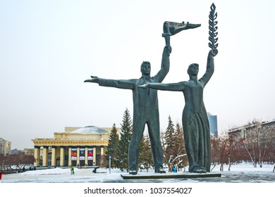Novosibirsk, Siberia , Russia-February 4, 2018: the building of the Novosibirsk state academic Opera and ballet theater and the sculptural composition of a young man with a torch and a girl with ears