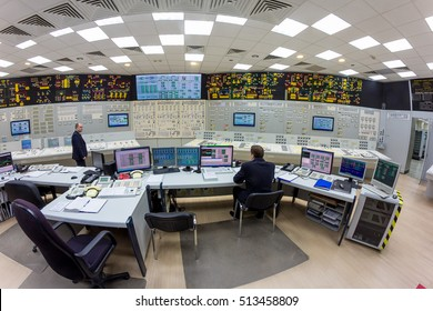 Novovoronezh, Russia - April 04, 2015: Inside the control room of fifth power unit of the Novovoronezh Nuclear Power Plant. Engineer works on control panel. Blog tour to NPP, April 04 2015, in Russia
