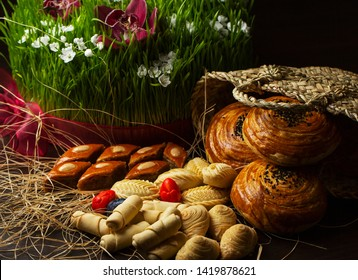 Novruz grass semeni and sweets pakhlava and gogal on the wooden table