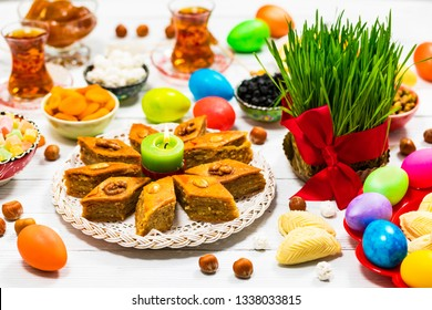 Novruz Ramadan in Azerbaijan. Colored Eggs, Wheat Springs for Easter and Traditional Sweets. Selective focus.