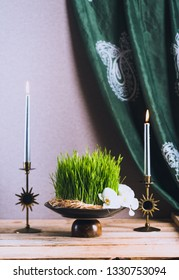 Novruz still life with semeni sabzi wheat grass , silk national scarf, eastern musical instrument and orchids. Spring equinox in March celebration, copy space