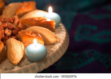 Novruz tray with Azerbaijan national pastry against silk scarf background