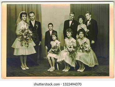 NOVY BOR, THE CZECHOSLOVAK SOCIALIST REPUBLIC - CIRCA 1970s: Vintage photo shows newlyweds and wedding guests. Retro black and white photography.