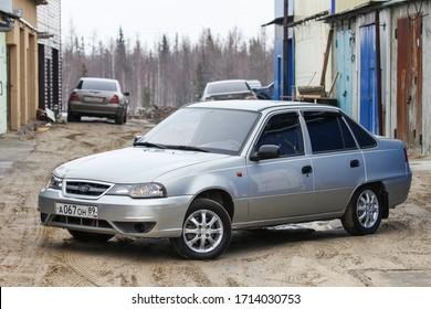 Novyy Urengoy, Russia - April 23, 2020: Silver motor car Daewoo Nexia in the city suburbs.
