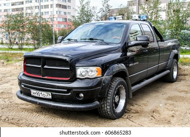 NOVYY URENGOY, RUSSIA - AUGUST 15, 2012: Black pickup truck Dodge Ram 2500 in the city street.