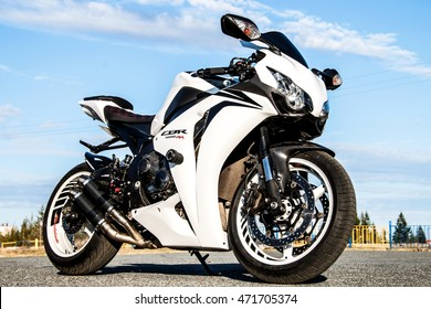 NOVYY URENGOY, RUSSIA - AUGUST 21, 2016: White bike Honda CBR-1000RR parked at the countryside.