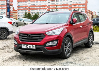 Novyy Urengoy, Russia - August 27, 2019: Red motor car Hyundai Santa Fe in the city street.