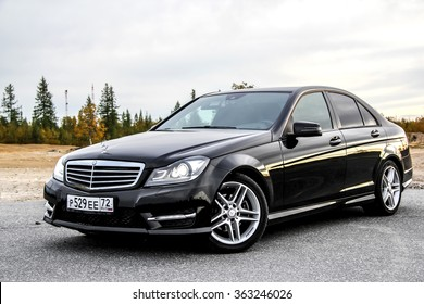 NOVYY URENGOY, RUSSIA - AUGUST 30, 2015: Motor car Mercedes-Benz W204 C-class at the countryside.