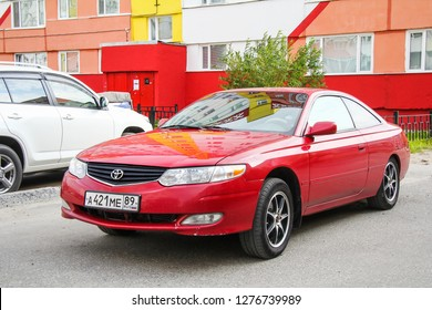 Novyy Urengoy, Russia - August 31, 2012: Red motor car Toyota Camry Solara in the city street.